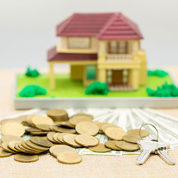 Planning savings money of coins to buy a home concept for proper